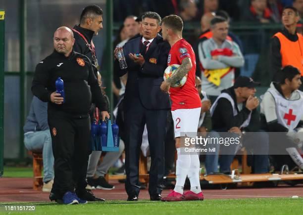Kieran Trippier of England speaks with Krasimir Balakov manager of Bulgaria during the UEFA Euro 2020 qualifier between Bulgaria and England on...