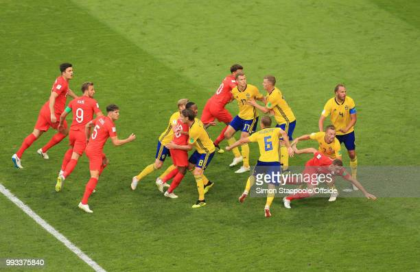 Kieran Trippier of England stumbles as players get held at an England corner kick during the 2018 FIFA World Cup Russia Quarter Final match between...