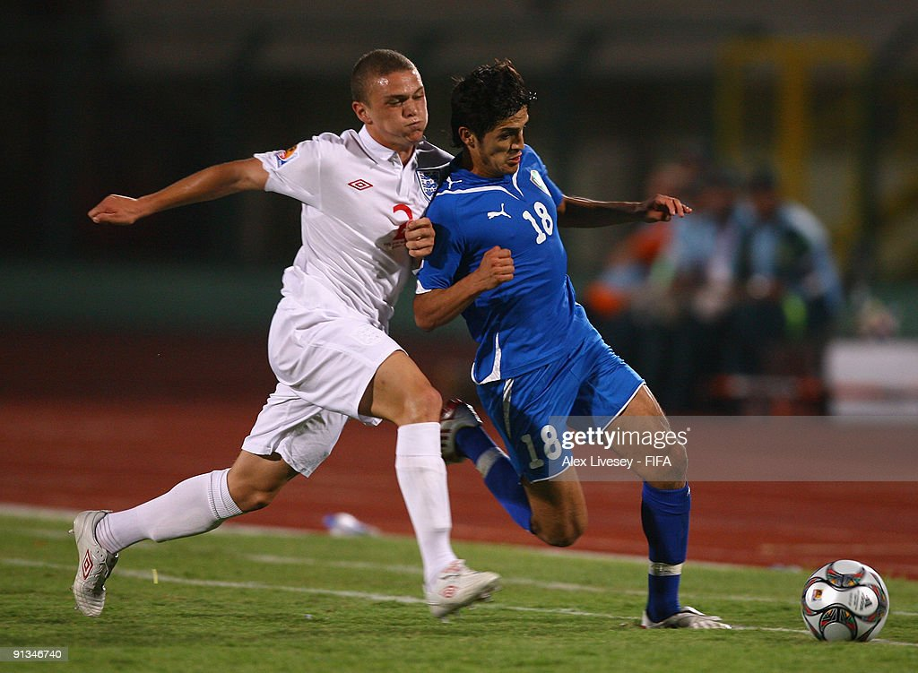 Kieran Trippier of England tackles Oybek Kilichev of Uzbekistan during the FIFA U20 World Cup Group D match between Uzbekistan and England at the Mubarak Stadium on October 2, 2009 in Suez, Egypt.