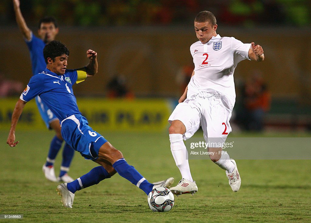 Kieran Trippier of England (R) tackles Sunnatilla Mamadaliyev of Uzbekistan during the FIFA U20 World Cup Group D match between Uzbekistan and England at the Mubarak Stadium on October 2, 2009 in Suez, Egypt.