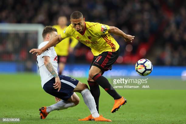 Kieran Trippier of Tottenham and Richarlison of Watford during the Premier League match between Tottenham Hotspur and Watford at Wembley Stadium on...