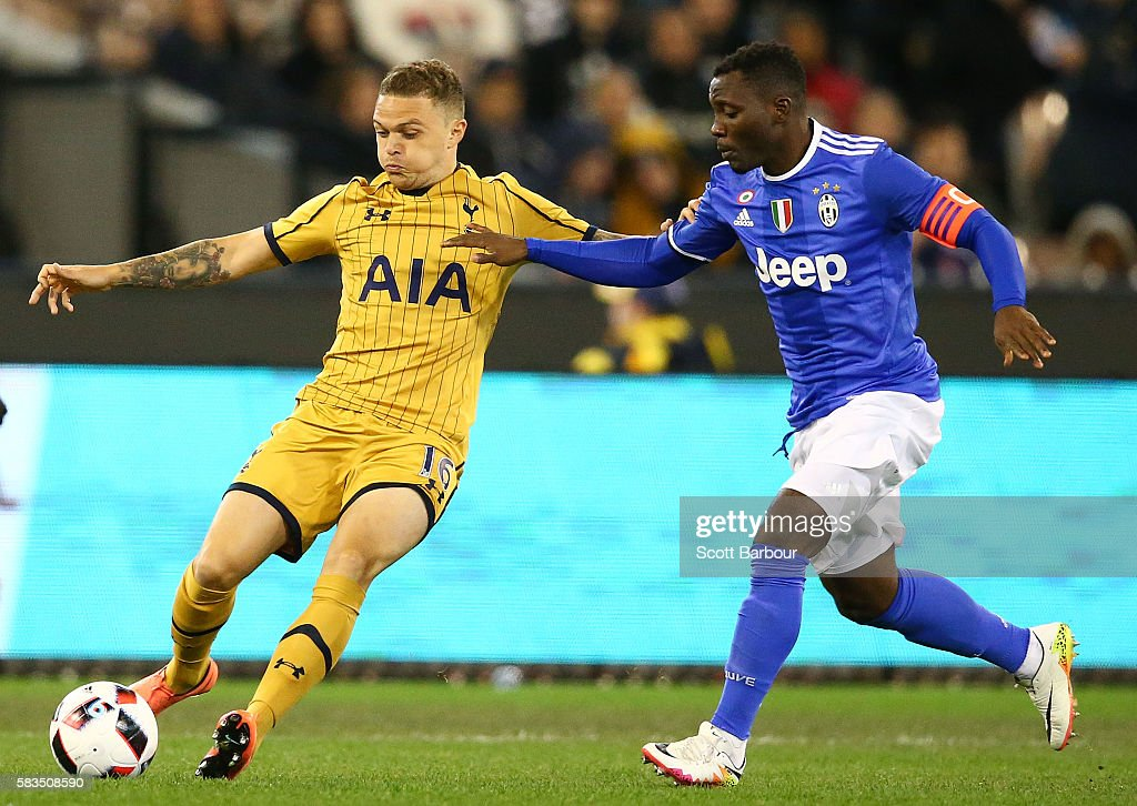 Kieran Trippier of Tottenham Hotspur and Kwadwo Asamoah of Juventus FC compete for the ball during the 2016 International Champions Cup match between Juventus FC and Tottenham Hotspur at Melbourne Cricket Ground on July 26, 2016 in Melbourne, Australia.