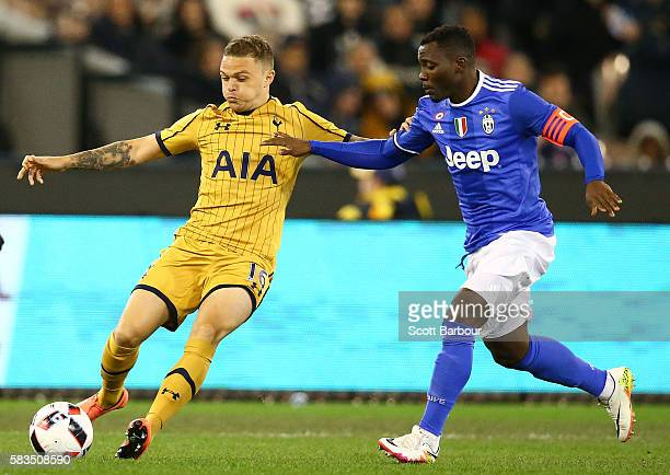 Kieran Trippier of Tottenham Hotspur and Kwadwo Asamoah of Juventus FC compete for the ball during the 2016 International Champions Cup match between...