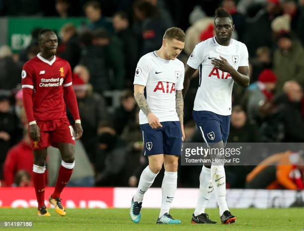 Kieran Trippier of Tottenham Hotspur and teammate Davinson Sanchez look dejected as they leave the pitch at half time during the Premier League match...