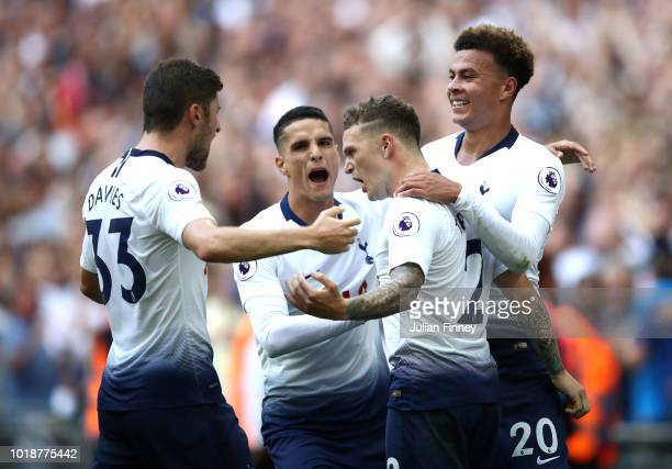 Kieran Trippier of Tottenham Hotspur celebrates scoring his team's second goal with team mates during the Premier League match between Tottenham...