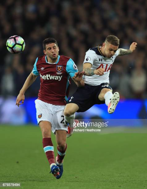 Kieran Trippier of Tottenham Hotspur clears the ball under pressure from Jonathan Calleri of West Ham United during the Premier League match between...