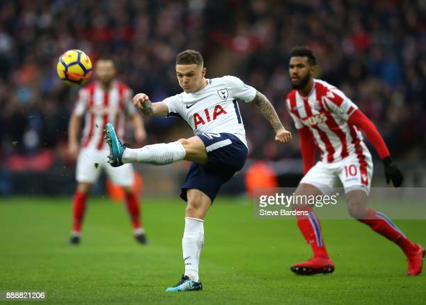 Kieran Trippier of Tottenham Hotspur clears the ball while under pressure from Maxim ChoupoMoting of Stoke City during the Premier League match...