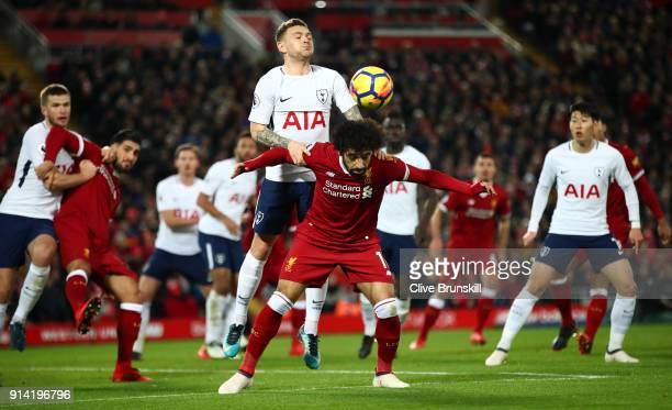 Kieran Trippier of Tottenham Hotspur competes for a header with Mohamed Salah of Liverpool during the Premier League match between Liverpool and...