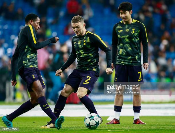 Kieran Trippier of Tottenham Hotspur excersises with teammates Kyle WalkerPeters and HeungMin Son during their warmingup prior to start the UEFA...