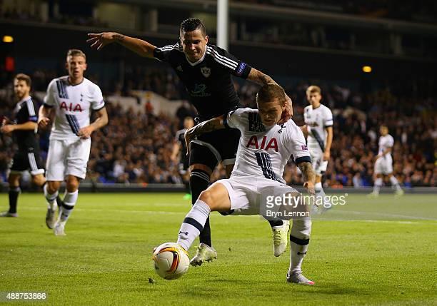 Kieran Trippier of Tottenham Hotspur holds off Reynaldo of FK Qarabag during the UEFA Europa League Group J match between Tottenham Hotspur FC and...