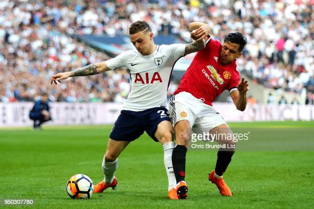 Kieran Trippier of Tottenham Hotspur is challenged by Alexis Sanchez of Manchester United during The Emirates FA Cup Semi Final match between...