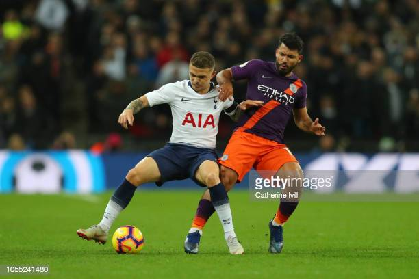 Kieran Trippier of Tottenham Hotspur is challenged by Sergio Aguero of Manchester City during the Premier League match between Tottenham Hotspur and...