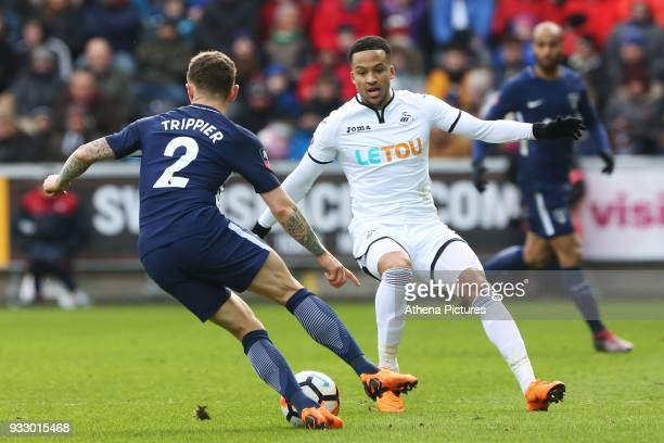 Kieran Trippier of Tottenham Hotspur is marked by Martin Olsson of Swansea during the Fly Emirates FA Cup Quarter Final match between Swansea City...