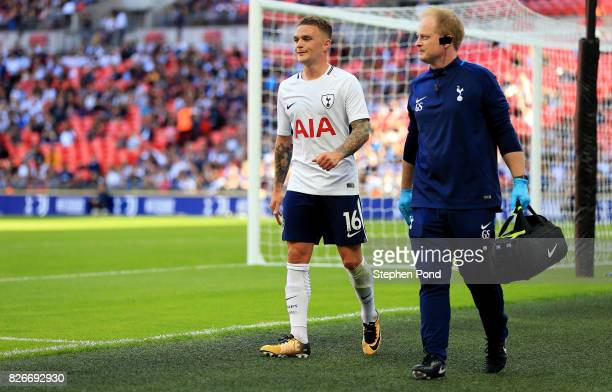 Kieran Trippier of Tottenham Hotspur leaves the field injured during the PreSeason Friendly match between Tottenham Hotspur and Juventus on August 5...