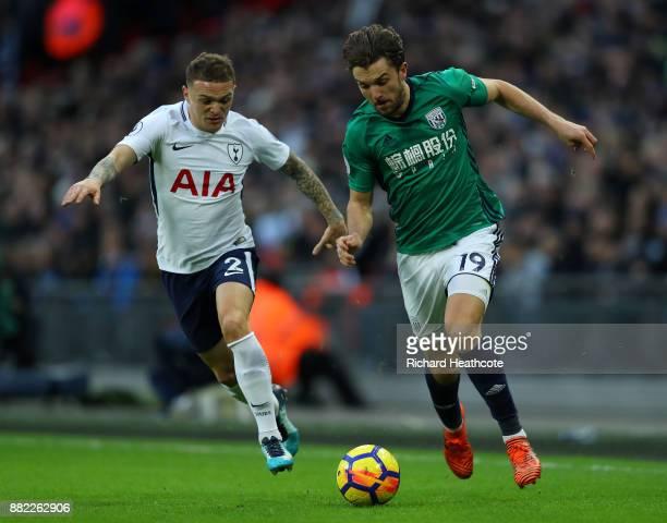 Kieran Trippier of Tottenham Hotspur puts pressure on Jay Rodriguez of West Bromwich Albion during the Premier League match between Tottenham Hotspur...