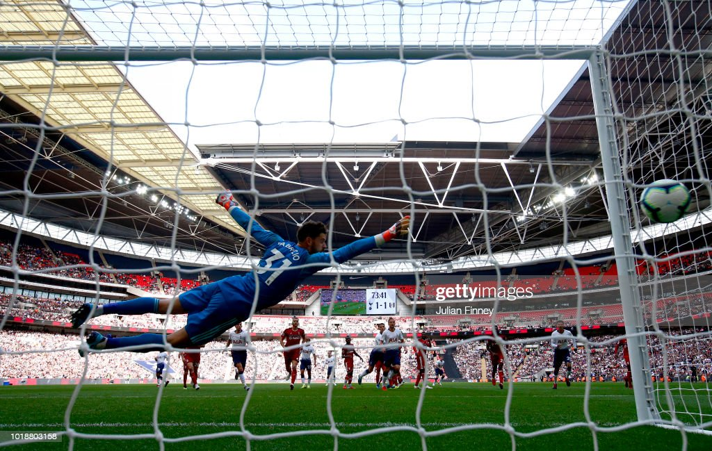 Kieran Trippier of Tottenham Hotspur scores his team's second goal during the Premier League match between Tottenham Hotspur and Fulham FC at Wembley Stadium on August 18, 2018 in London, United Kingdom.