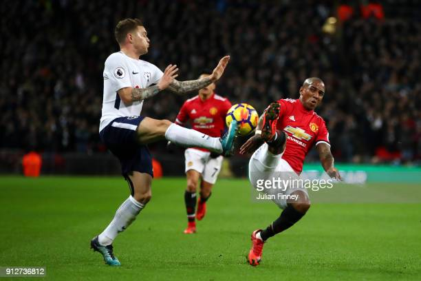 Kieran Trippier of Tottenham Hotspur tackles Ashley Young of Manchester United during the Premier League match between Tottenham Hotspur and...