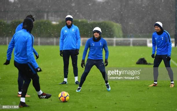 Kieran Trippier of Tottenham Hotspur takes part in a Tottenham Hotspur Training Session as HeungMin Son of Tottenham Hotspur and Eric Dier of...