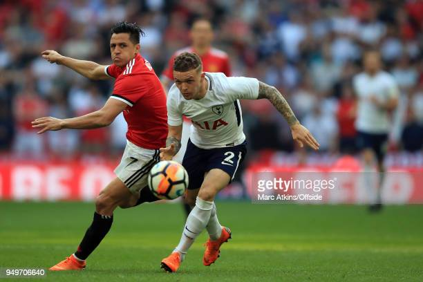 Kieran Trippier of Tottenham Hotspur tangles with Alexis Sanchez of Manchester United during the Emirates FA Cup Semi Final at Wembley Stadium...