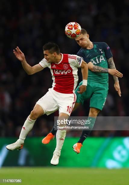 Kieran Trippier of Tottenham Hotspur wins a header over Dusan Tadic of Ajax during the UEFA Champions League Semi Final second leg match between Ajax...