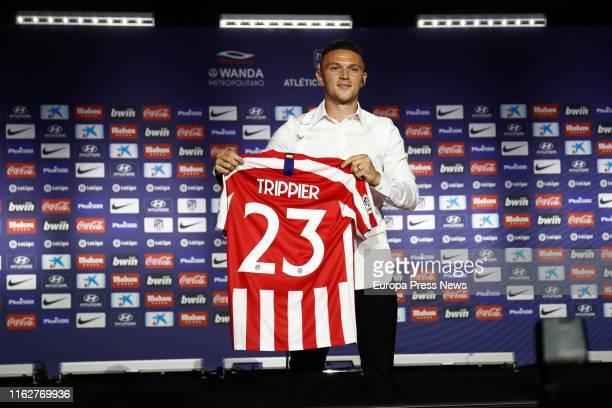Kieran Trippier poses with his tshirt during his presentation as a new football player of Atletico de Madrid at Estadio Wanda Metropolitano on July...