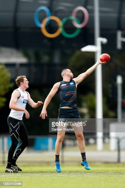 Kieren Briggs of the Giants taps the ball during a Greater Western Sydney Giants AFL training session at Holden Centre on August 05, 2021 in...
