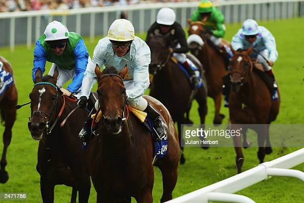 Kieren Fallon and Islington lead the Jimmy Fortune ridden Ocean Silk home to land The Aston Upthorpe Yorkshire Oaks Race run on August 20, 2003 at...