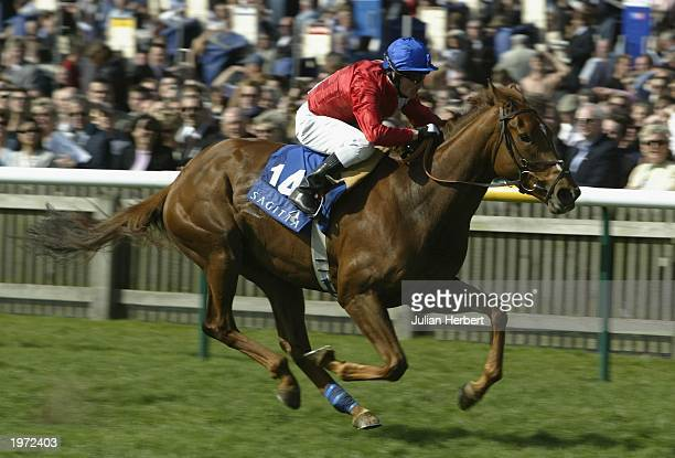 Kieren Fallon and Russian Rhythm storm home to land The Sagitta 1000 Guineas Stakes Race run at Newmarket Racecourse on May 4, 2003 in Newmarket,...