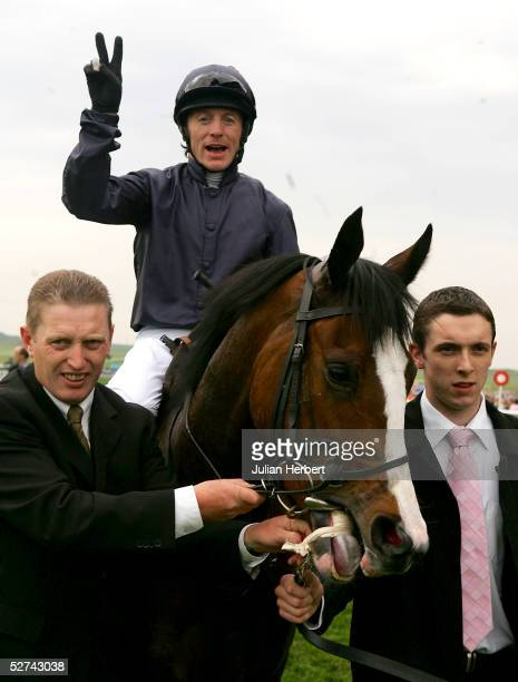 Kieren Fallon celebrates after he and Virginia Waters left the field behind them to land The Ultimatepokercom 1000 Guineas Stakes Race run at...