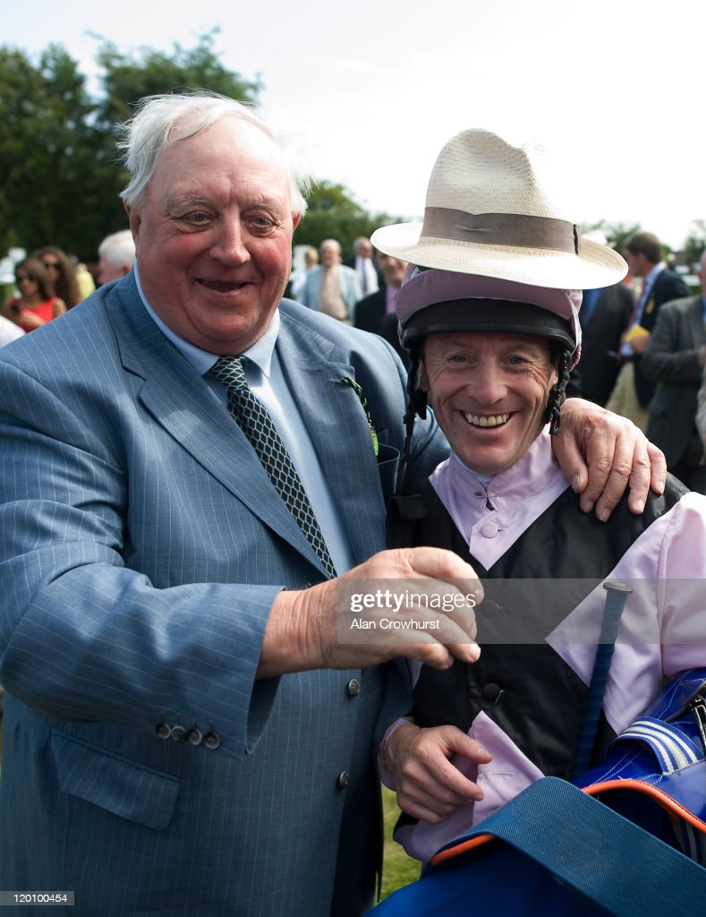 Kieren Fallon (R) celebrates with trainer Mick Easterby after riding Hoof It to win the Blue Square Stewards' Cup as he at Goodwood racecourse on July 30, 2011 in Chichester, England.