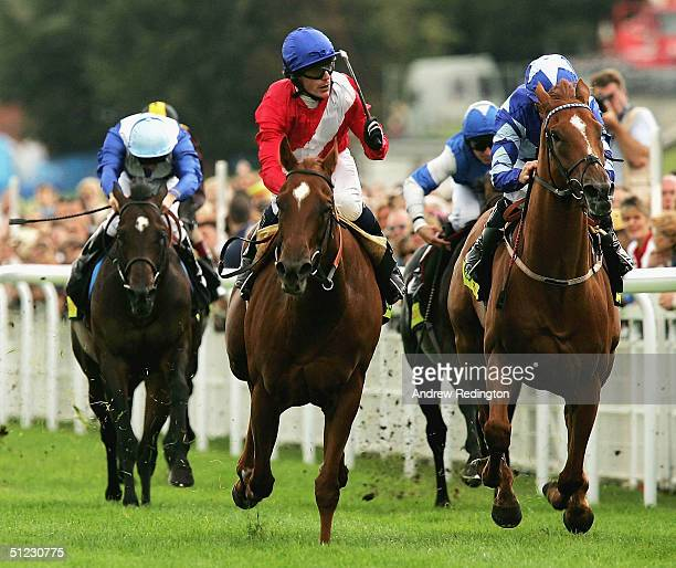 Kieren Fallon rides Chic to victory over the favourite Nayyir during the Totesport Celebration Mile at Goodwood racecourse on August 28 2004 in...