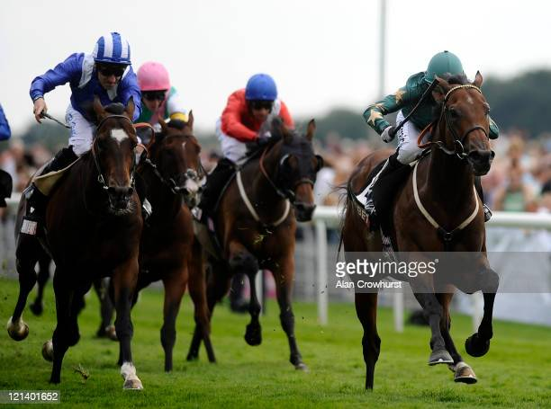 Kieren Fallon riding Green Destiny win The Sky Bet Mobile Strensall Stakes at York racecourse on August 19 2011 in York England