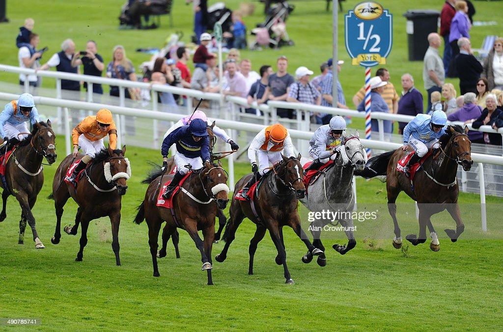 Kieren Fallon riding Navajo Chief (C, orange cap) win The Betfred Hambleton Stakes at York racecourse on May 15, 2014 in York, England.