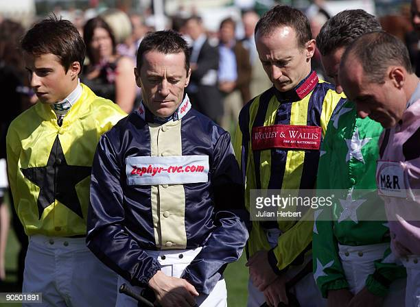 Kieren Fallon stands with colleagues as they observe a moment of silence in memory of two jockeys who died recently before The Wilkinson Frenchgate...