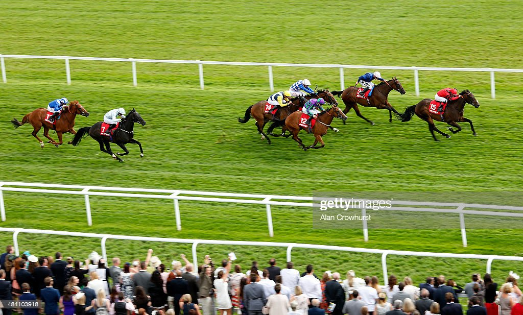 Kieren Fox riding Mullionheir (R) win The Betfred 'Supports Jack Berry House' Ladies Day Handicap Stakes at Newbury racecourse on August 15, 2015 in Newbury, England.