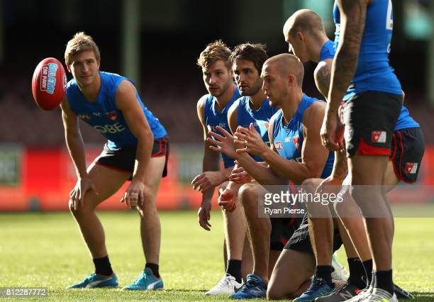 Kieren Jack Alex Johnson Josh Kennedy and Sam Reid of the Swans train during a Sydney Swans AFL training session at Sydney Cricket Ground on July 11...