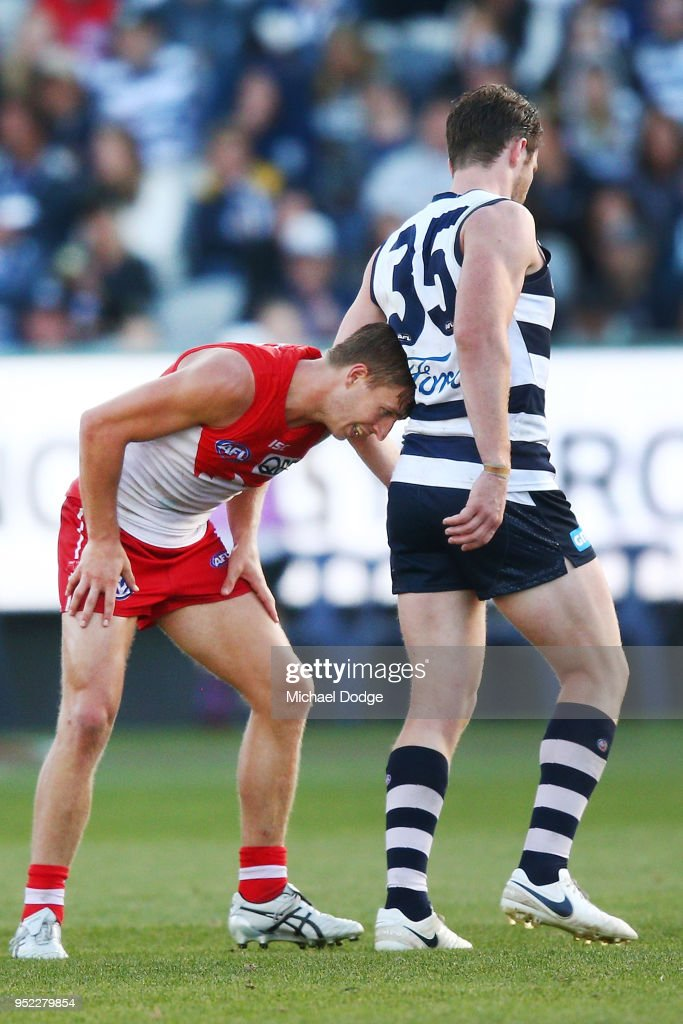 Kieren Jack of the Swans annoys Patrick Dangerfield of the Cats by putting his head into his back during the round six AFL match between the Geelong Cats and Sydney Swans at GMHBA Stadium on April 28, 2018 in Geelong, Australia.