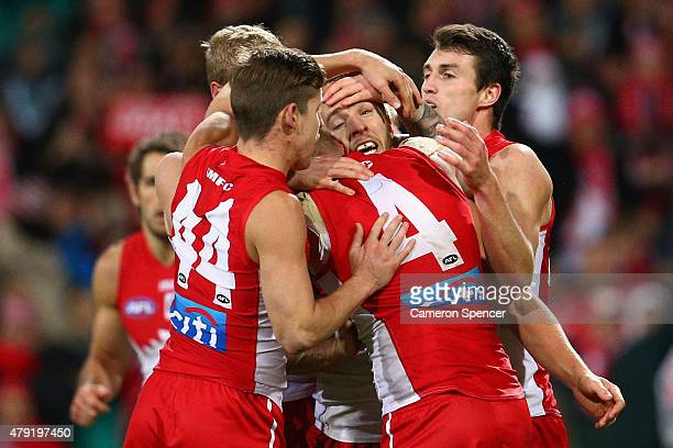Kieren Jack of the Swans celebrates scoring a goal with team mates during the round 14 AFL match between the Sydney Swans and the Port Adelaide Power...