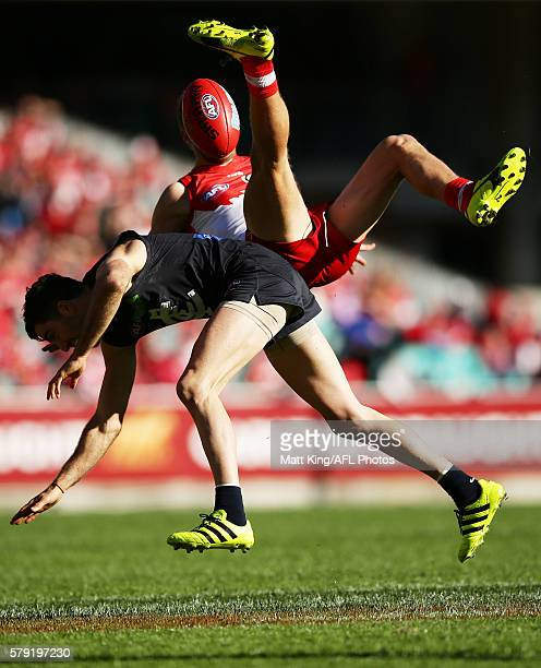Kieren Jack of the Swans competes for the ball against Kade Simpson of the Blues during the round 18 AFL match between the Sydney Swans and the...