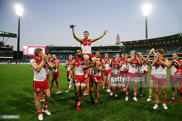 Kieren Jack of the Swans is chaired off the field during the round 13 AFL match between the Sydney Swans and the Port Adelaide Power at Sydney...