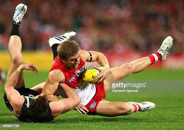 Kieren Jack of the Swans is tackled during the round 20 AFL match between the Sydney Swans and the Collingwood Magpies at SCG on August 14 2015 in...
