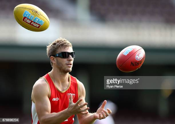 Kieren Jack of the Swans of the Swans trains with vision distortion glasses on during a Sydney Swans AFL training session at Sydney Cricket Ground on...