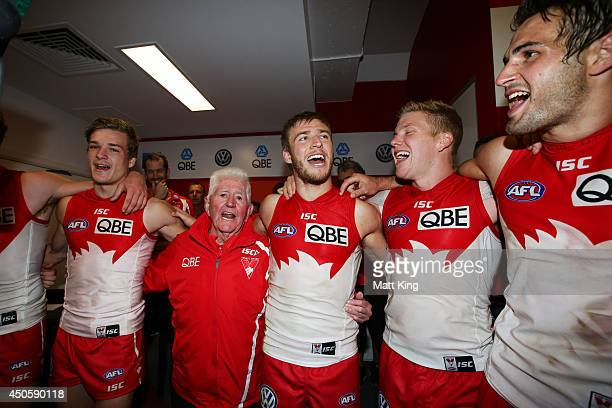 Kieren Jack of the Swans sings the club song with team mates after during the round 13 AFL match between the Sydney Swans and the Port Adelaide Power...
