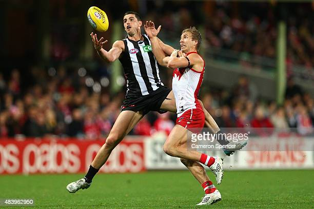 Kieren Jack of the Swans spoils the ball of Scott Pendlebury of the Magpies during the round 20 AFL match between the Sydney Swans and the...