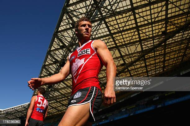 Kieren Jack of the Swans walks onto the field during a Sydney Swans AFL training session at ANZ Stadium on August 28 2013 in Sydney Australia