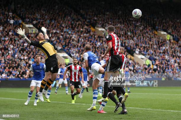 Kieren Westwood of Sheffield Wednesday attempts to save from Chris Basham of Sheffield United during the Sky Bet Championship match between Sheffield...