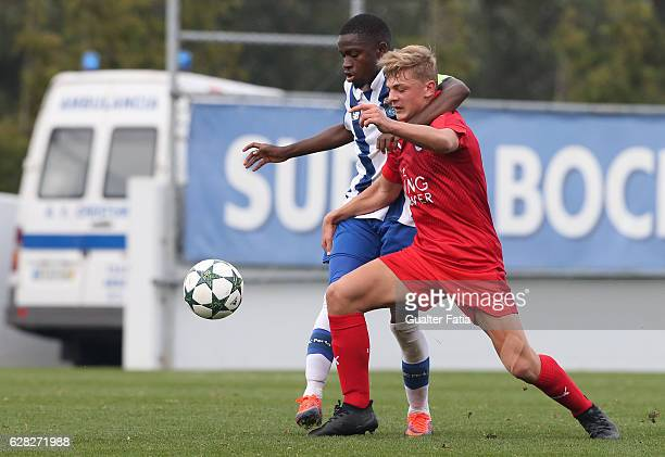 Kiernan DewsburyHall of Leicester City FC with FC Porto's midfielder Moreto Cassama in action during the UEFA Youth Champions League match between FC...