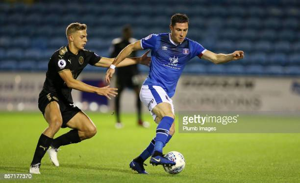Kiernan DewsburyHall of Leicester City in action with Mike Jones of Carlisle United during the EFL Checkatrade Trophy tie between Carlisle United and...