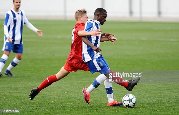 Kiernan DewsburyHall of Leicester City in action with Moreto Cassama of FC Porto during the UEFA Youth Champions Leagues match between FC Porto and...