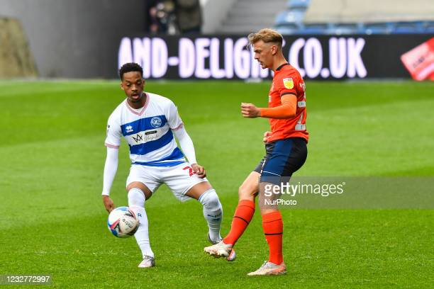 Kiernan Dewsbury-Hall of Luton town battles for possession with Chris Willock of QPR during the Sky Bet Championship match between Queens Park...